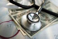 Getty_rf_photo_of_stethoscope_money_calendar