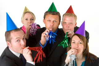 1143110employeesinparty hats